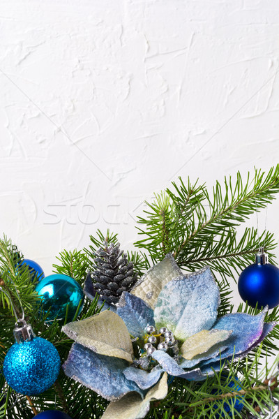 Christmas background with silver beads, blue silk poinsettias, c Stock photo © TasiPas