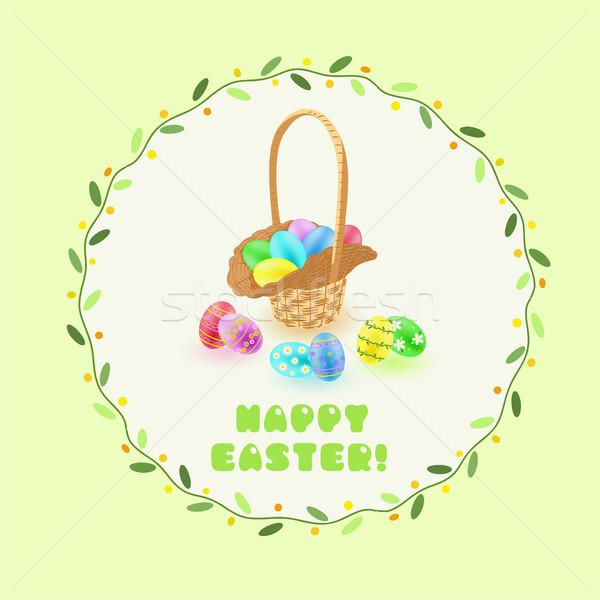 Easter eggs in the basket in green leaves frame Stock photo © TasiPas