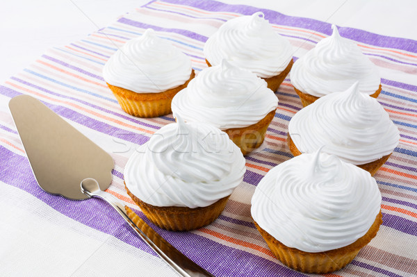 White cupcakes on the striped napkin Stock photo © TasiPas