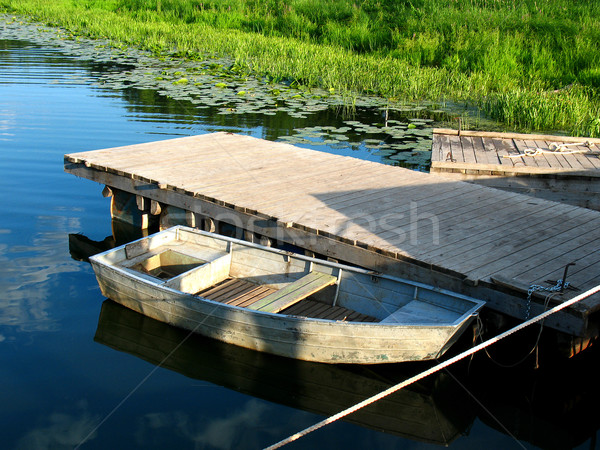 Wooden boat on the river wharf on a lovely summer day Stock photo © tatiana3337