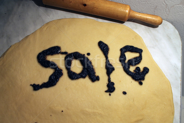 the word 'sale' made poppy filling on the rolled out dough Stock photo © tatiana3337