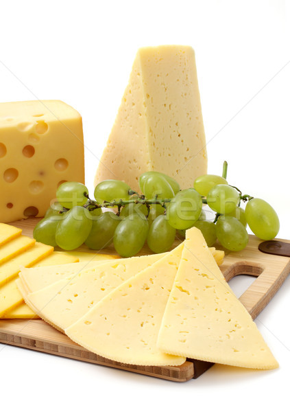 cheese and grapes on a white background Stock photo © Tatik22