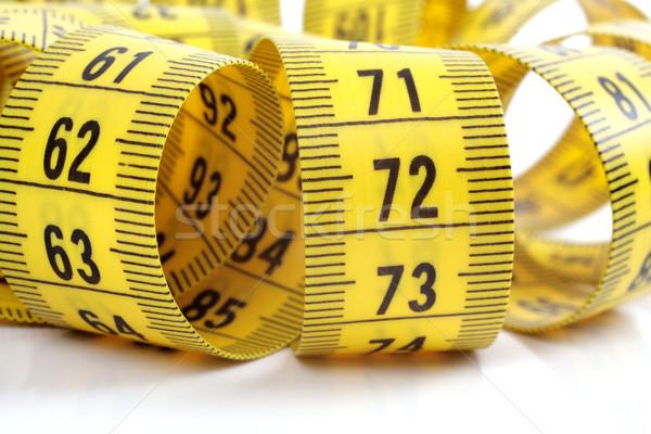 Centymetrem odizolowany biały taśmy żółty władcy Zdjęcia stock © Tatik22