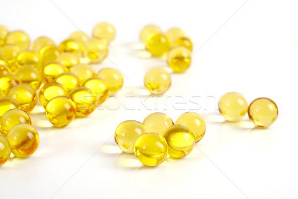 Jel kapsül vitaminler mineraller beyaz Stok fotoğraf © Tatik22