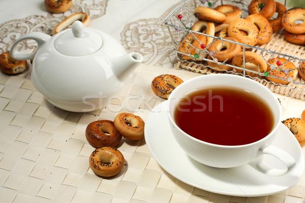 Photo of a tea mug and teapot with black tea Stock photo © Tatik22