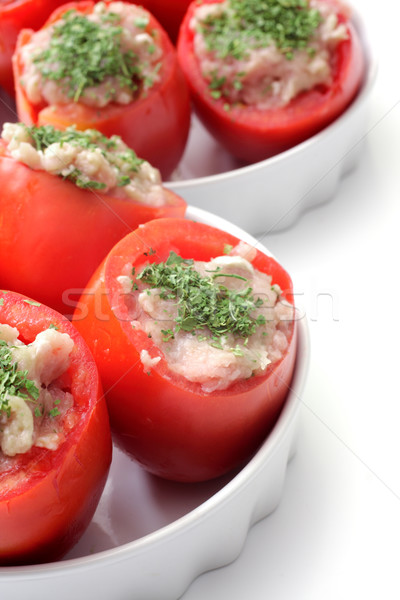 Cooking tomatoes stuffed with chicken meat in a white mold Stock photo © Tatik22