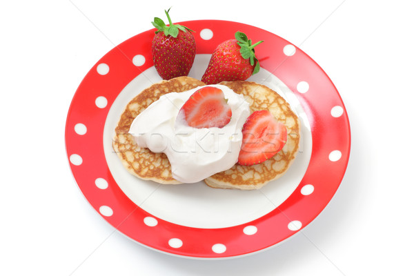 Fritters with sour cream and a strawberry on a plate Stock photo © Tatik22