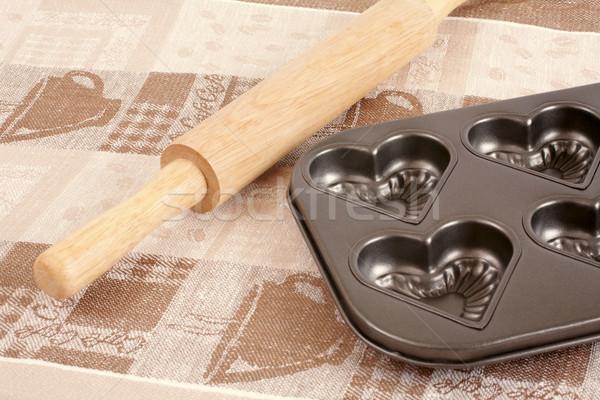 Battledore and muffins pan Stock photo © Tatik22