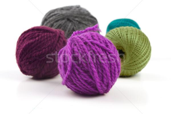Several balls of wool on a white background Stock photo © Tatik22