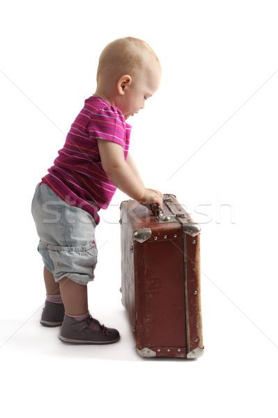 Küçük çocuk ayakta bavul beyaz yalıtılmış Stok fotoğraf © Tatik22
