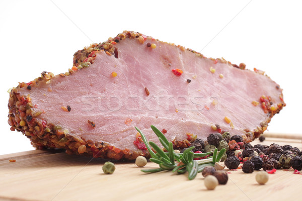 Smoked meat, rosemary and fragrant pepper on a board Stock photo © Tatik22