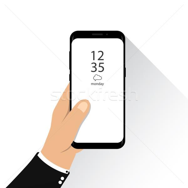 Kéz tart új verzió okostelefon kirakat Stock fotó © taufik_al_amin