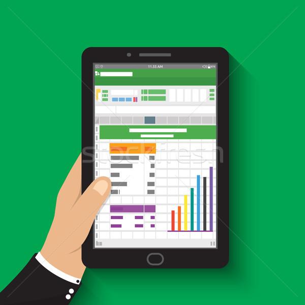 hand holding tablet. businessman read spreadsheet financial anal Stock photo © taufik_al_amin