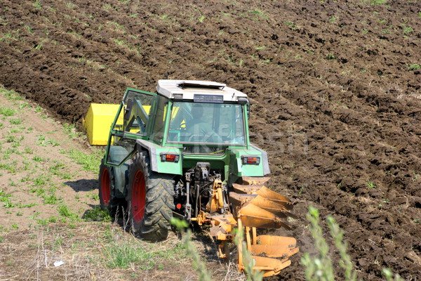 Tracteur terres vert printemps herbe travaux Photo stock © taviphoto