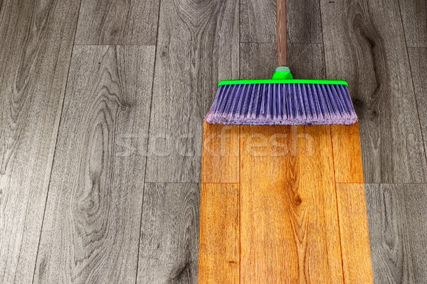 sweeping out wooden parquet Stock photo © taviphoto