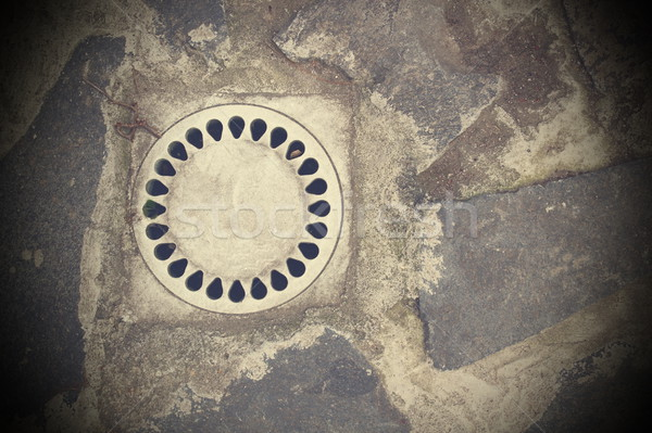 drainage on stone paved street Stock photo © taviphoto