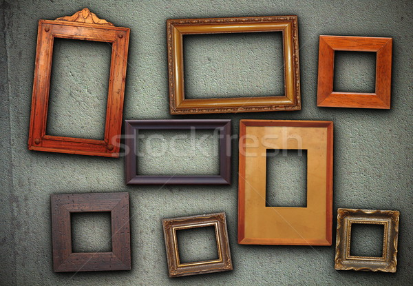 lots of picture frames hung on green wall Stock photo © taviphoto