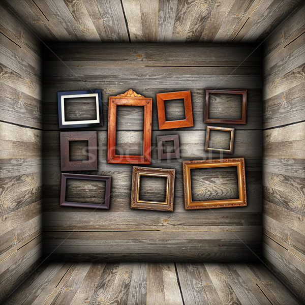 collection of beautiful frames on wood wall Stock photo © taviphoto