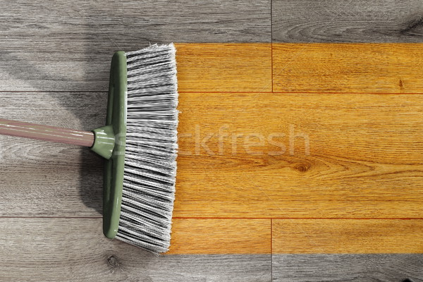 sweeping wooden floor with broom Stock photo © taviphoto