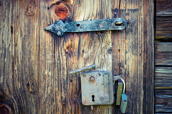 ancient locks on wooden door Stock photo © taviphoto