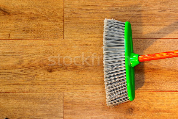 cleaning wooden floor with broom Stock photo © taviphoto