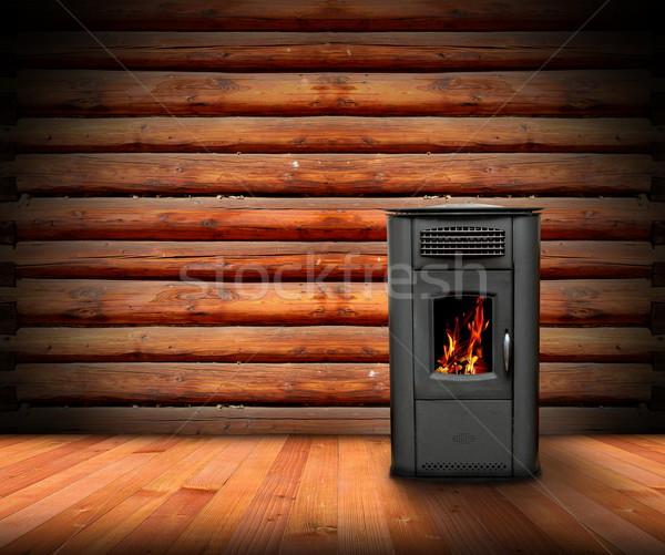 Chaud intérieur bois brûlant poêle Photo stock © taviphoto
