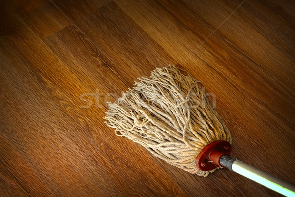 washing the wood floor with an old mop Stock photo © taviphoto