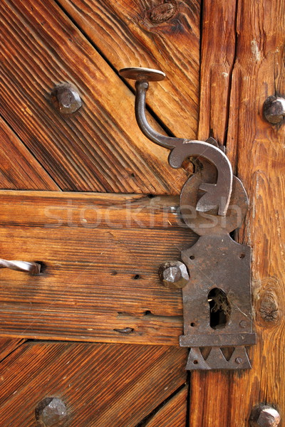 ancient latch on beautiful wooden door Stock photo © taviphoto