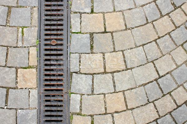 drainage on stone paved street Stock photo © taviphoto