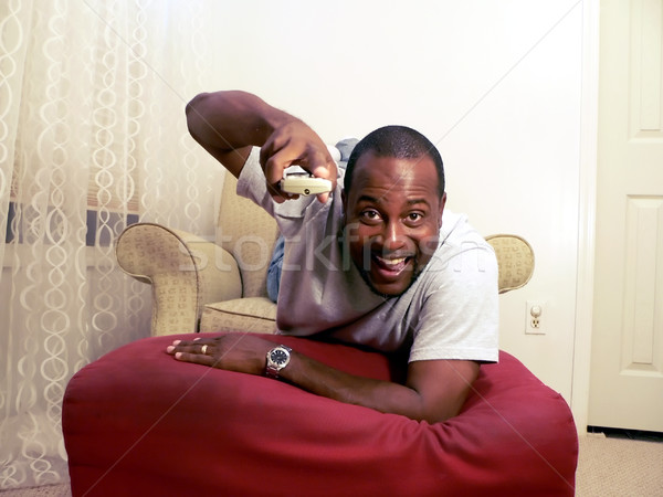 african american man watching tv 2 Stock photo © tdoes