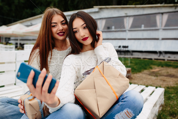 Two girls make selfie with gifts Stock photo © tekso