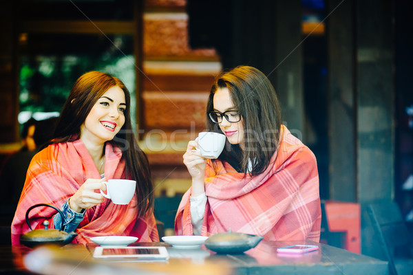 Two young and beautiful girls gossiping Stock photo © tekso