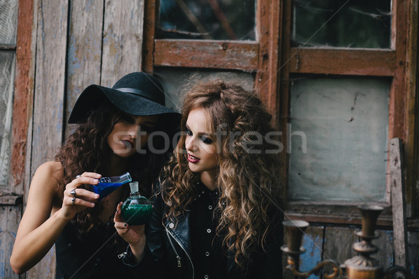 Two vintage witches perform magic ritual Stock photo © tekso