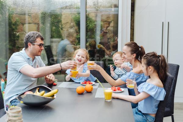 Happy family eating fresh fruit breakfast Stock photo © tekso
