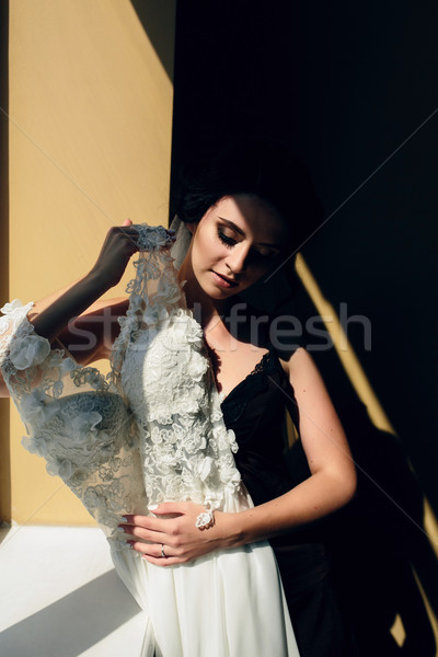 bride sitting holds wedding dress Stock photo © tekso