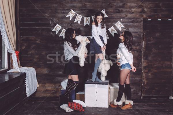 Three charming girls playing Stock photo © tekso