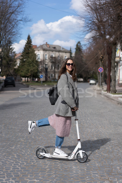 Young girl posing on a scooter Stock photo © tekso