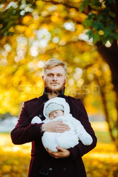 Apa újszülött fiú ősz park pózol Stock fotó © tekso