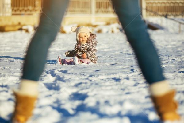 Little girl sitting in the snow Stock photo © tekso