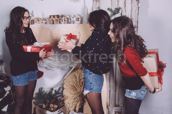 Gyönyörű lány csere ajándékok új év dekoratív klasszikus Stock fotó © tekso