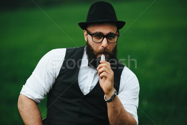 man with a beard smokes electronic cigarette Stock photo © tekso