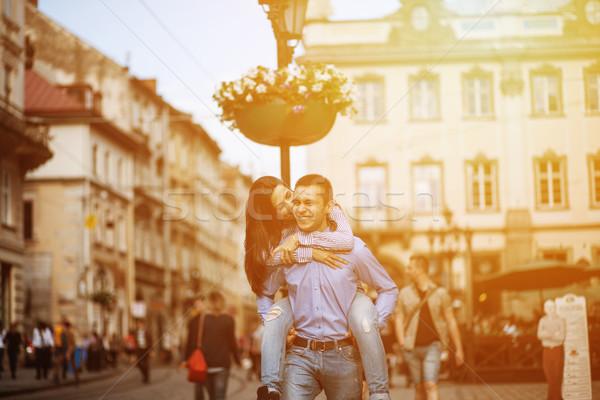 Pareja diversión ciudad hombre mujer posando Foto stock © tekso