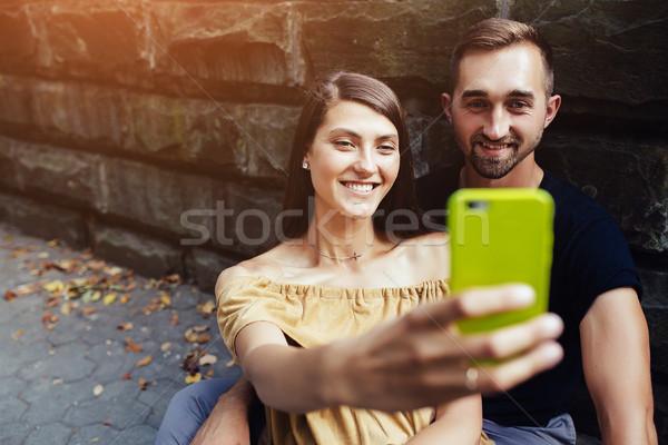 Jonge mooie paar vergadering grond Stockfoto © tekso