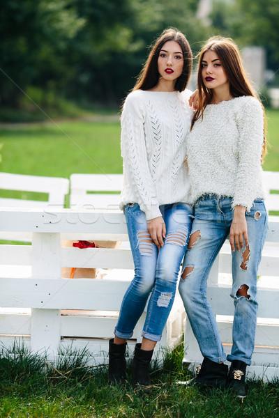 Two girls lean bench Stock photo © tekso