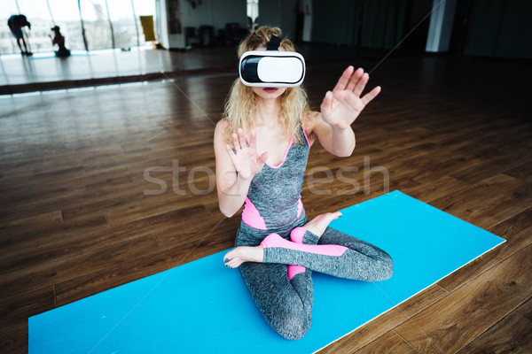 Woman in yoga class with VR headset Stock photo © tekso