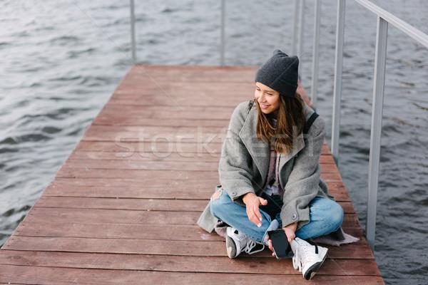 Fiatal csinos lány fából készült pad öreg Stock fotó © tekso