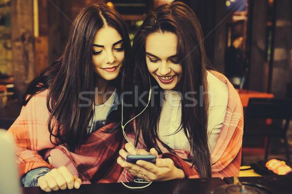 два девушки сидят молодые красивая девушка Сток-фото © tekso