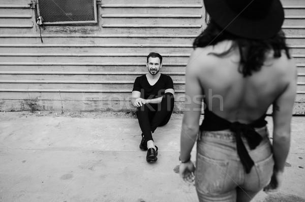 Fille homme femme famille sourire mur Photo stock © tekso