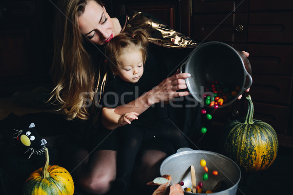mother and daughter playing together at home Stock photo © tekso