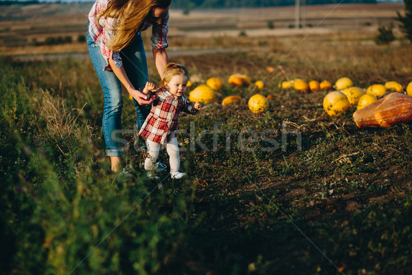 mother teaching her daughter to walk Stock photo © tekso